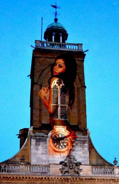 "All Saints Church, in Northampton, complete with the giant 30ft projected image of a semi-naked model Jasmine Jardot.  See NTI story NTICHURCH.  A casino has sparked outrage by beaming a giant 30ft image of a semi-naked model onto the side of a CHURCH - to promote a STRIP POKER tournament.  Parishioners of All Saints Church, in Northampton, were left ""disgusted"" after the pic of the scantily-clad glamour model was plastered across their historic bell-tower on Saturday night (8/2).  The image of sexy Jasmine Jardot, 23, wearing skimpy lingerie, lit up the night sky in the East Midland's town much to the horror of parish priest David McConkey.  Furious Father McConkey said yesterday (Mon) the projected picture was beamed onto the side of the Church of England building without his permission.  He is now demanding an apology from Aspers Casino who carried out the stunt to promote a Valentine's Day strip poker event this coming Friday (14/2)."